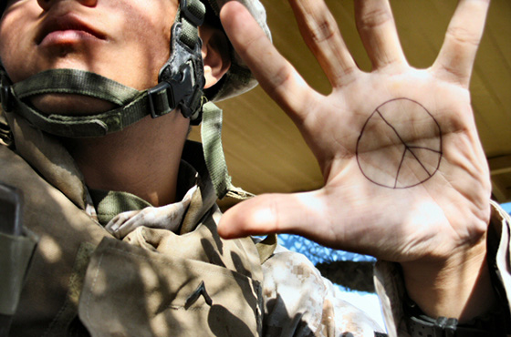 peace sign on soldier's hand